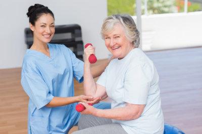 lady therapist assisting senior woman