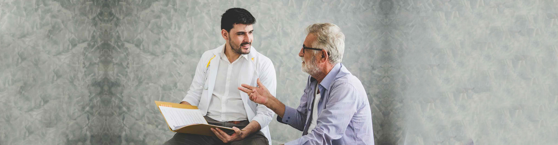 a therapist and a senior man talking